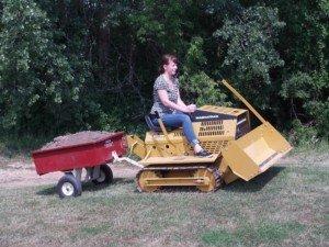 MAGNATRAC® RS196Ksmall bulldozer preparing a field for planting