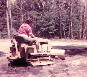 1978-MT1800-Charlotte-pulling-gravel-backup-driveway_293x262